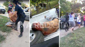 Impactante video: disparó al aire en un partido de fútbol infantil y lo lincharon a piñas patadas
