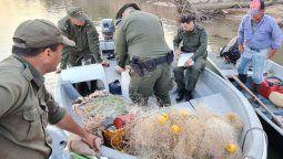 Mientras no exista otra decisión judicial, el Gobierno está obligado a garantizar la prohibición de la pesca comercial y deportiva en el Paraná.